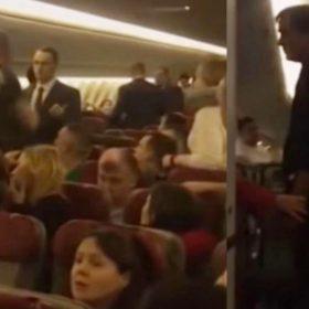 Drunk man tries to open aeroplane door during mid flight Passengers wraps him video